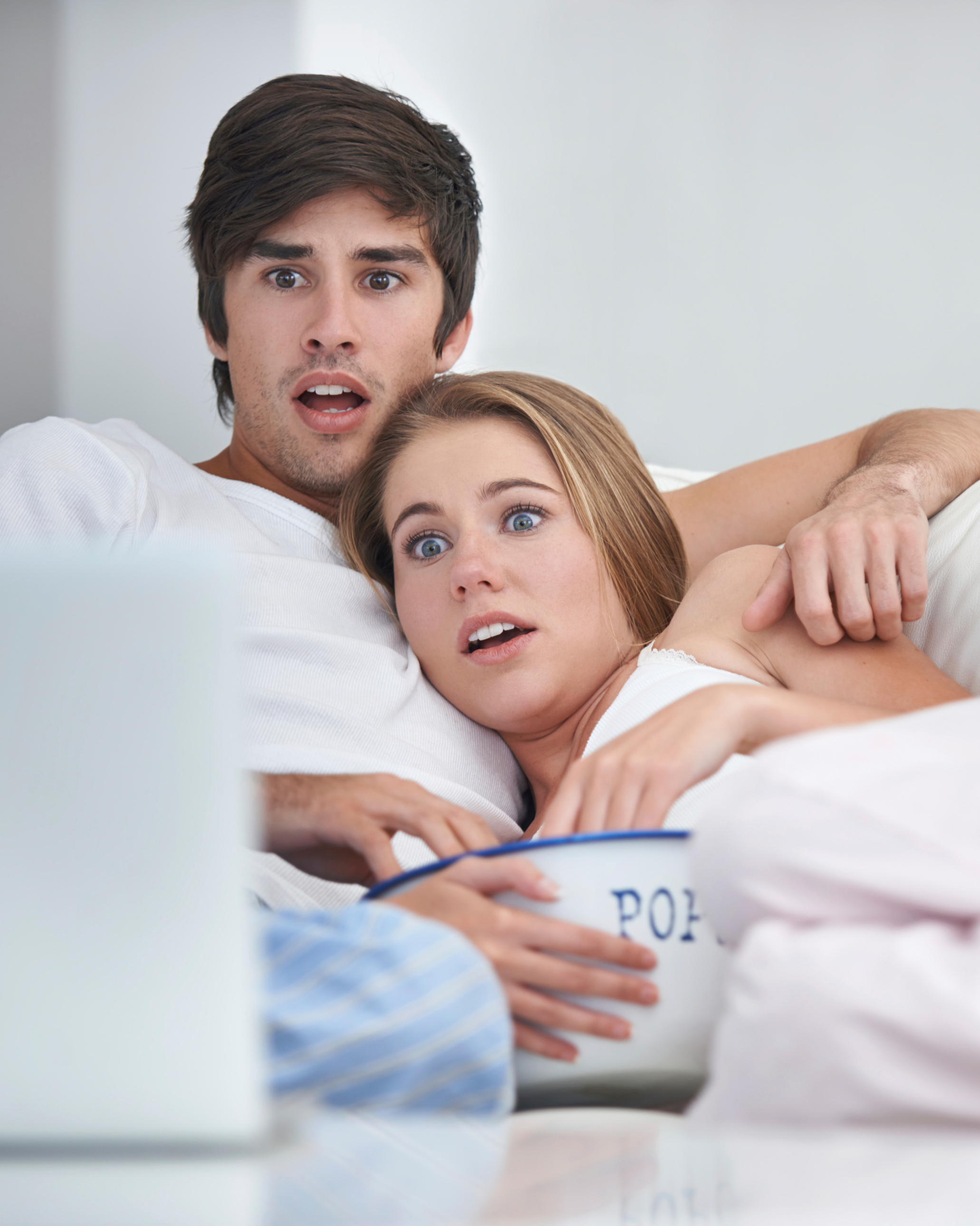 shocked-scared-couple-on-couch-watching-movie-with-popcorn-0116.jpg