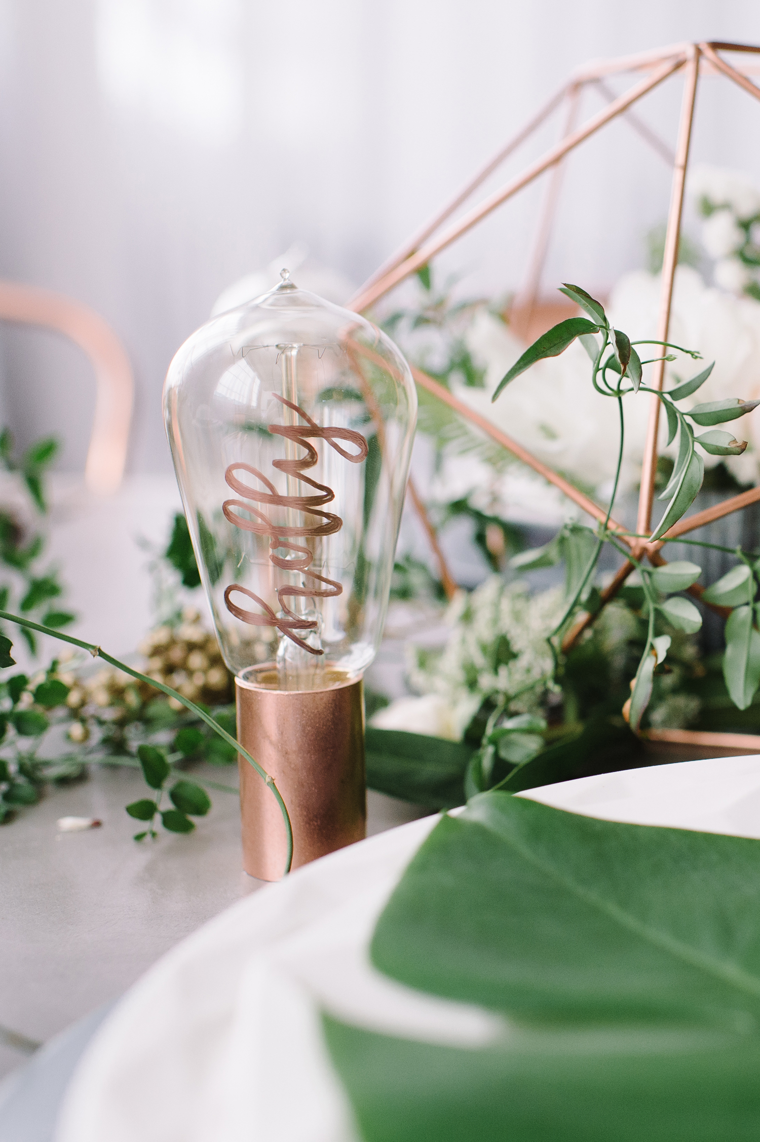 rose gold wedding ideas lightbulbs with calligraphy