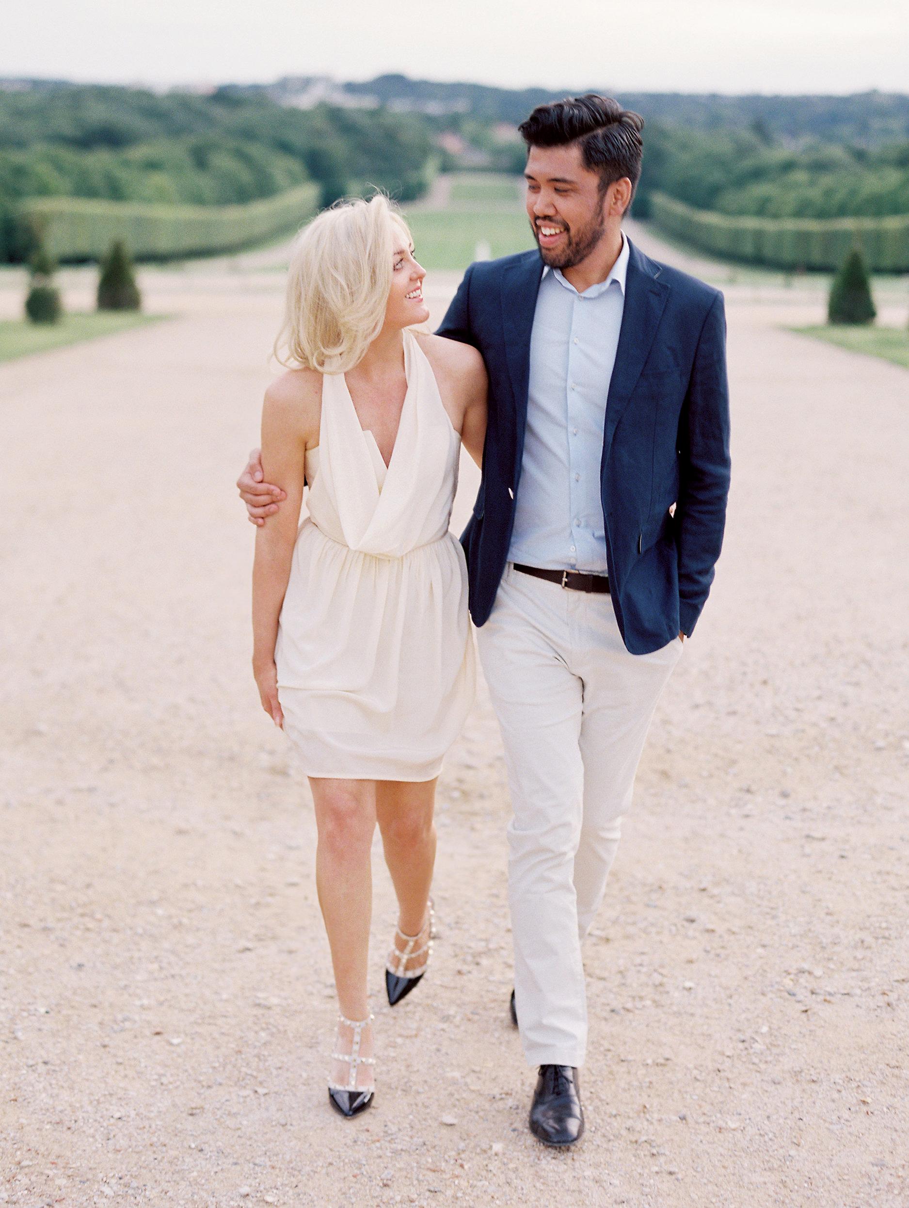 engaged couple walking outdoors