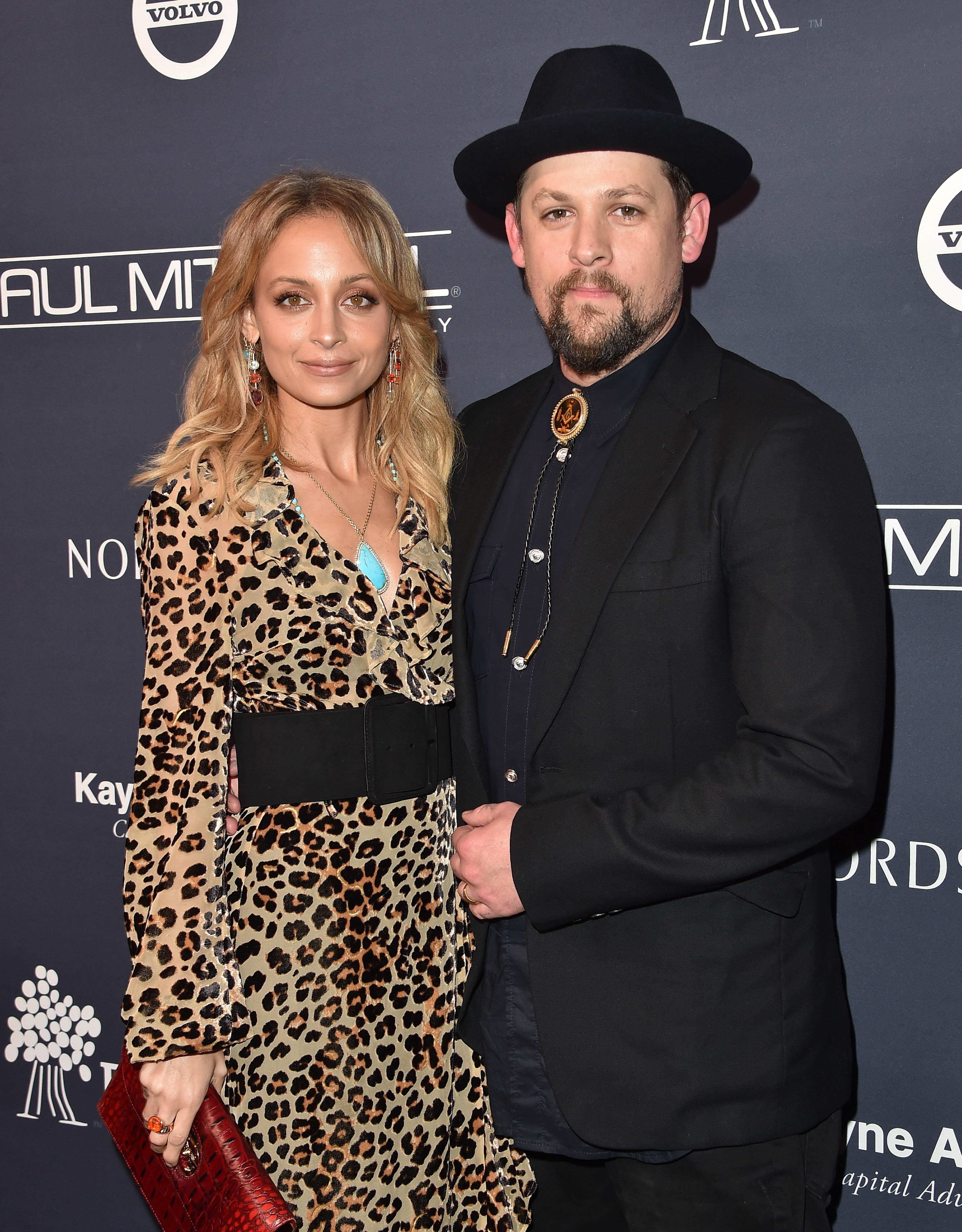 celebrity couple nicole joel black suit leopard print dress