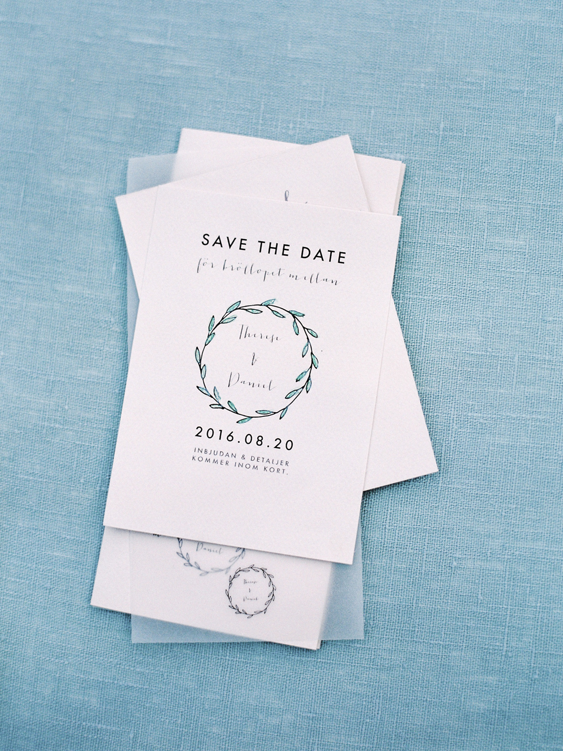 white stationary with black writing invitations