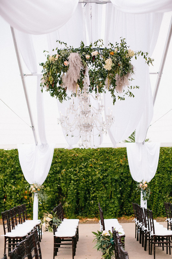 chandelier with greenery and rustic decor accents