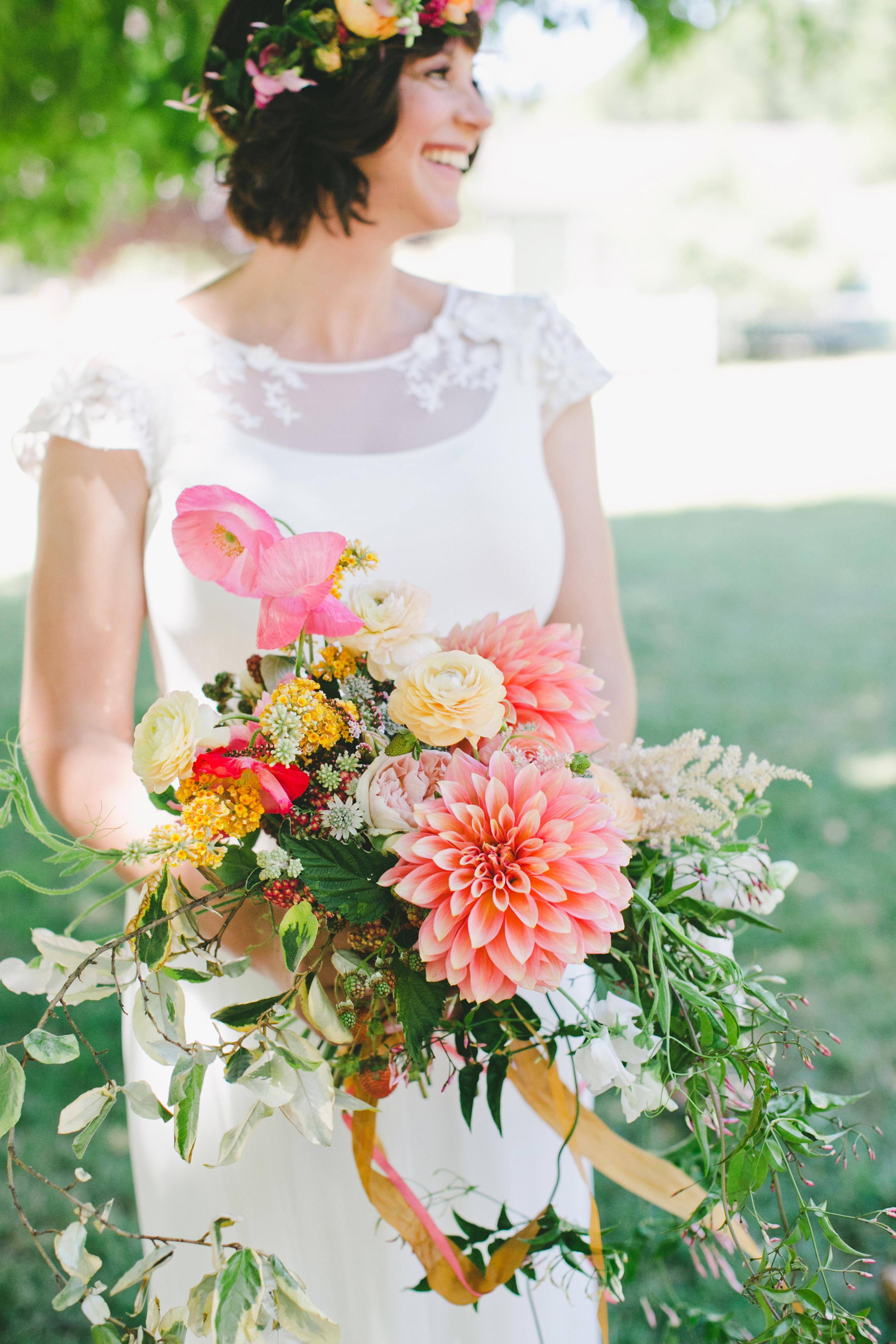 bride with dahlia bouquet orange yellow white
