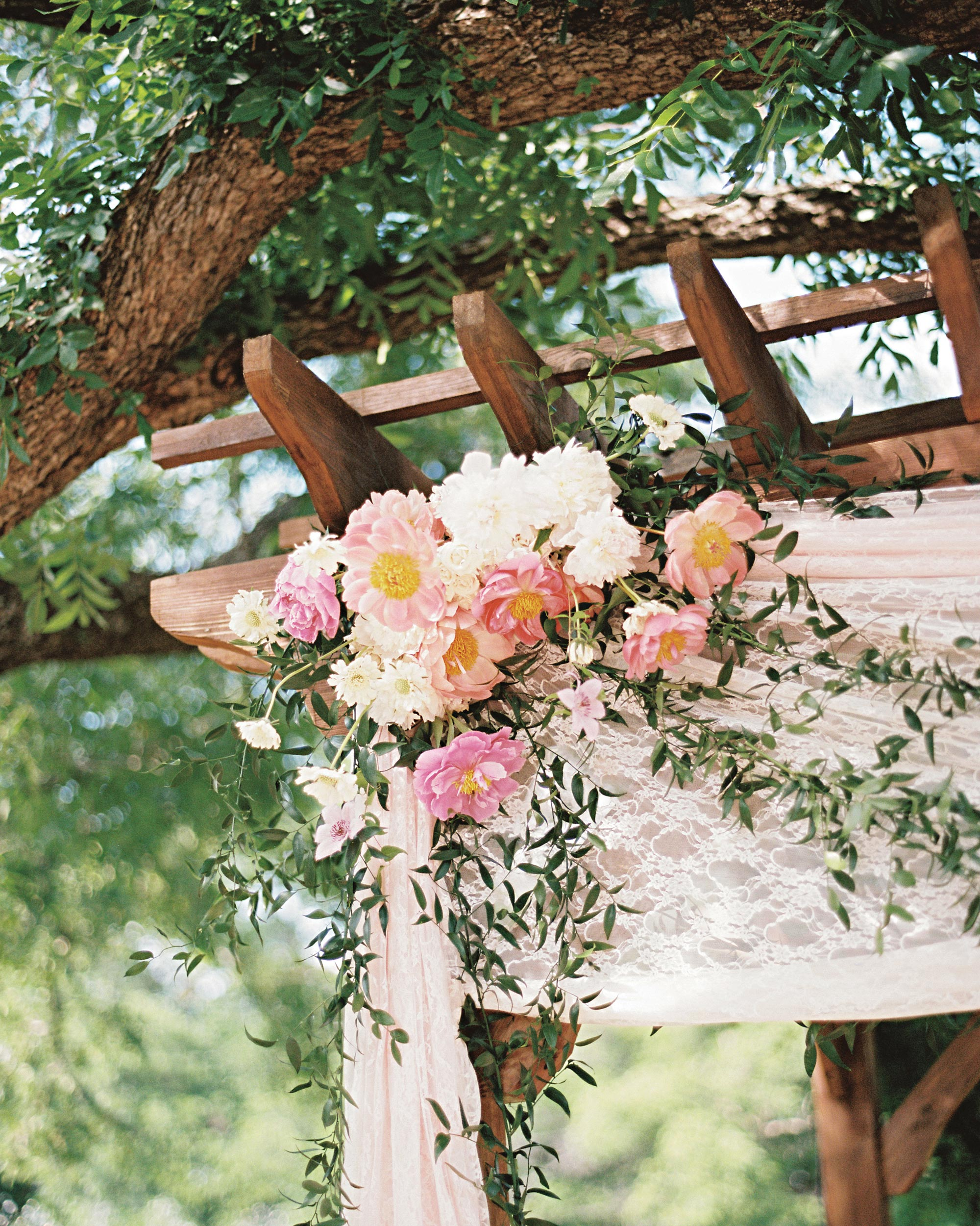 david-tyler-real-wedding-ceremony-arch-with-flowers.jpg