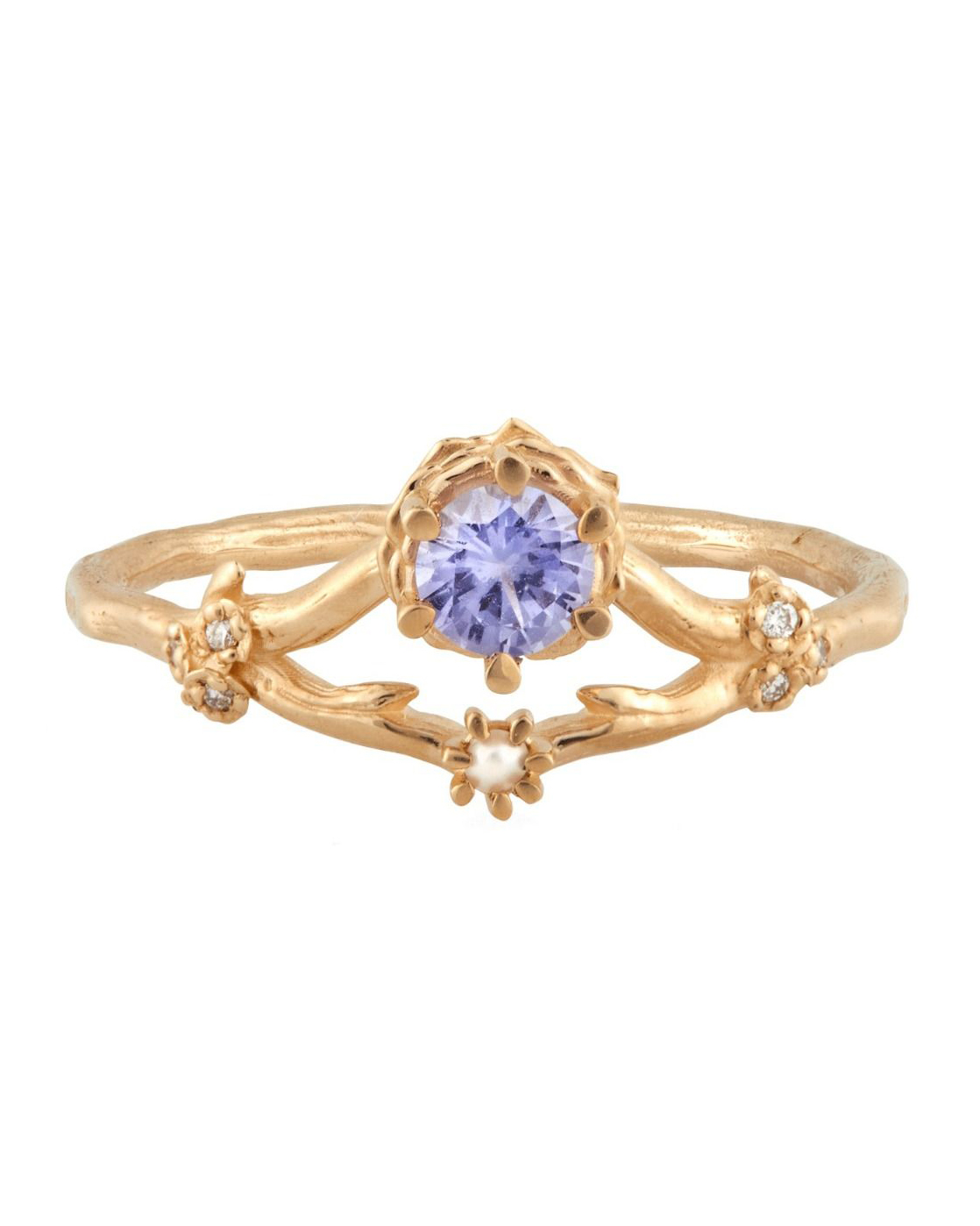 purple gemstone on gold band ring