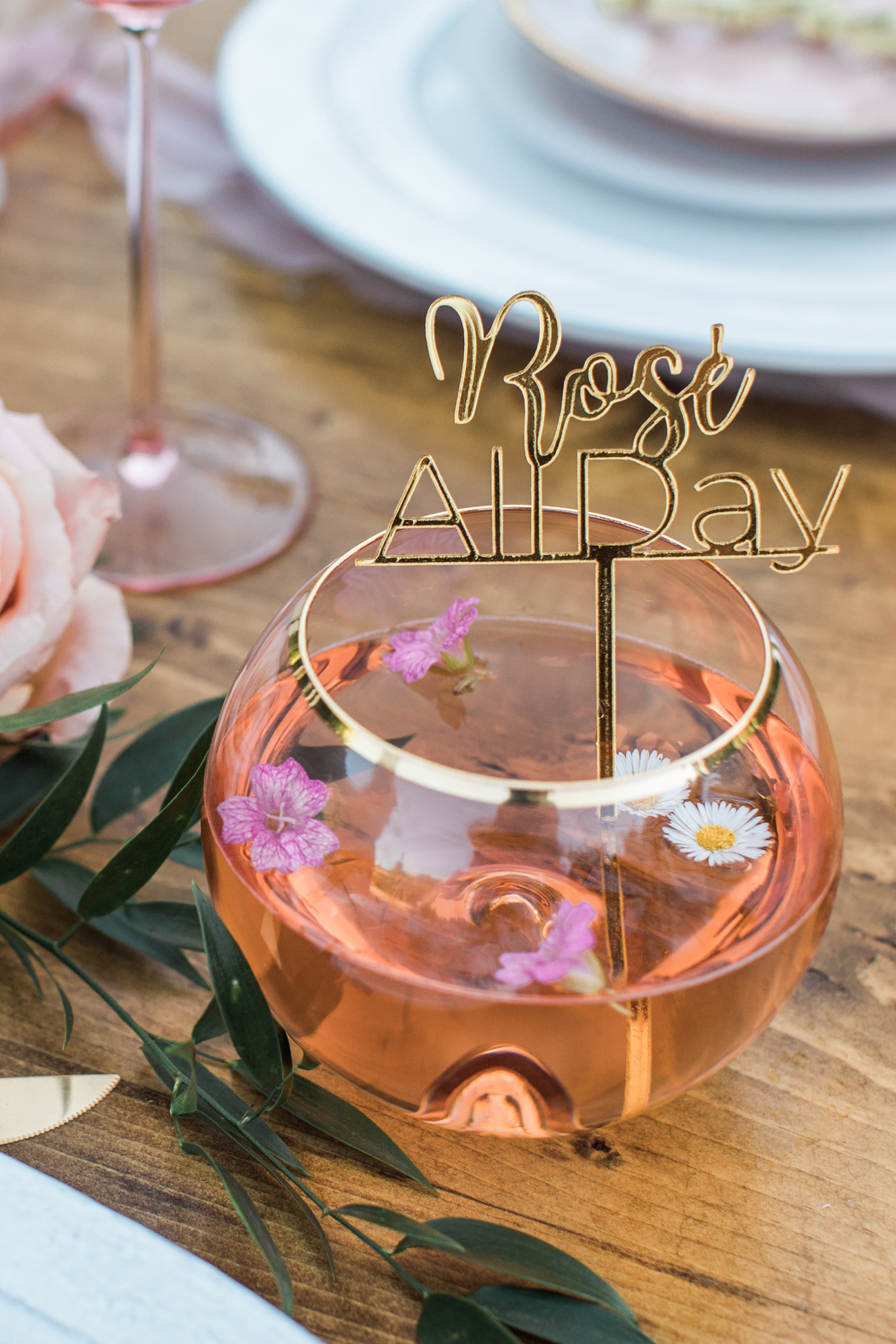 rose all day cocktail servers in gold rimmed glasses