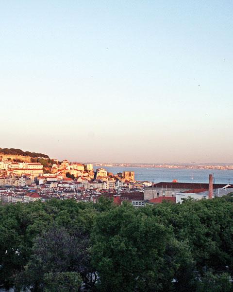travel-new-places-sun-setting-over-city-portugul.jpg