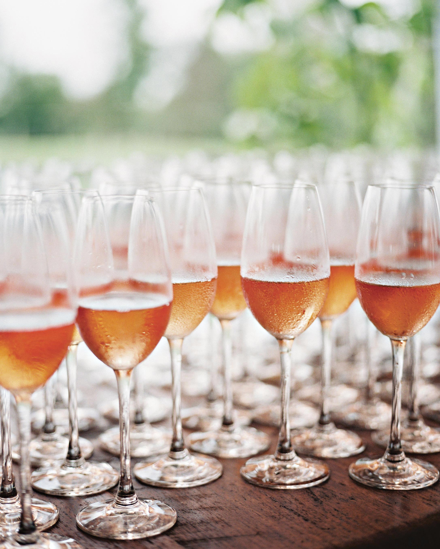 stephanie-mike-wedding-north-carolina-rose-champagne-glasses-cocktail-hour-63-s112048.jpg