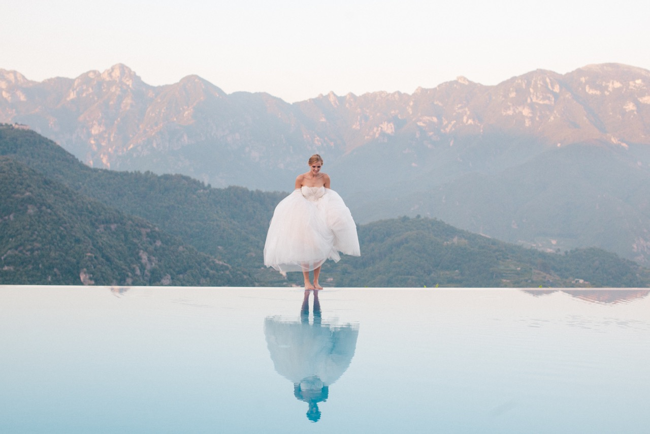 bride on edge of infinity pool