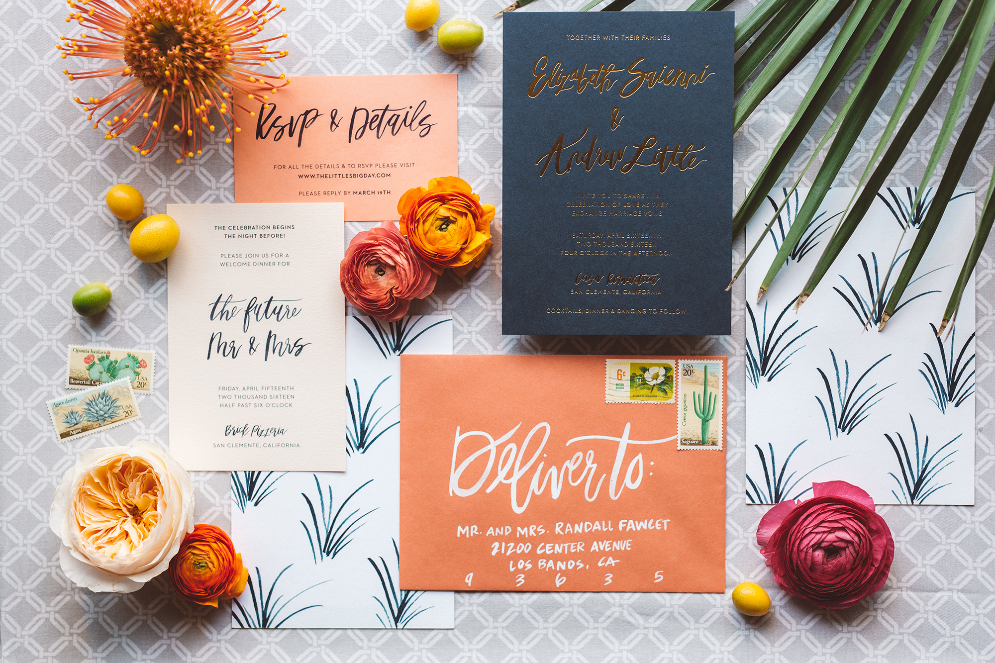 Bright peach and navy wedding invitations with calligraphy