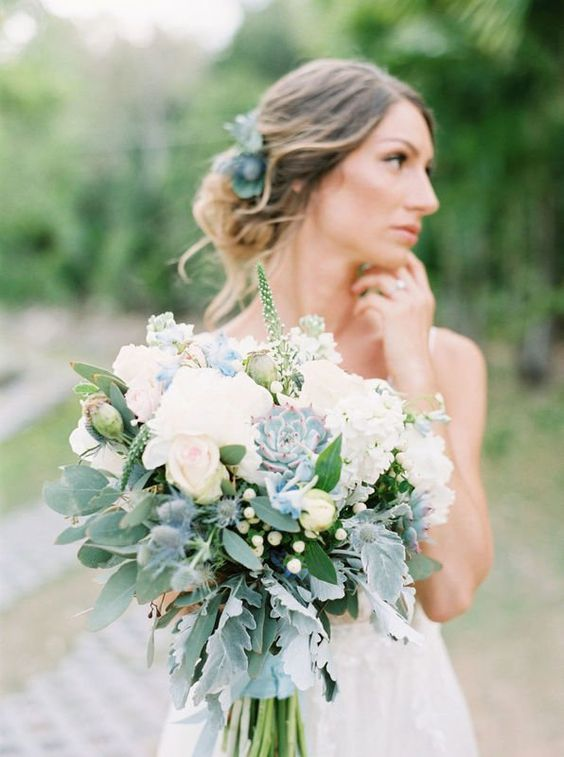bridal bouquet of blue succulents greenery and white roses