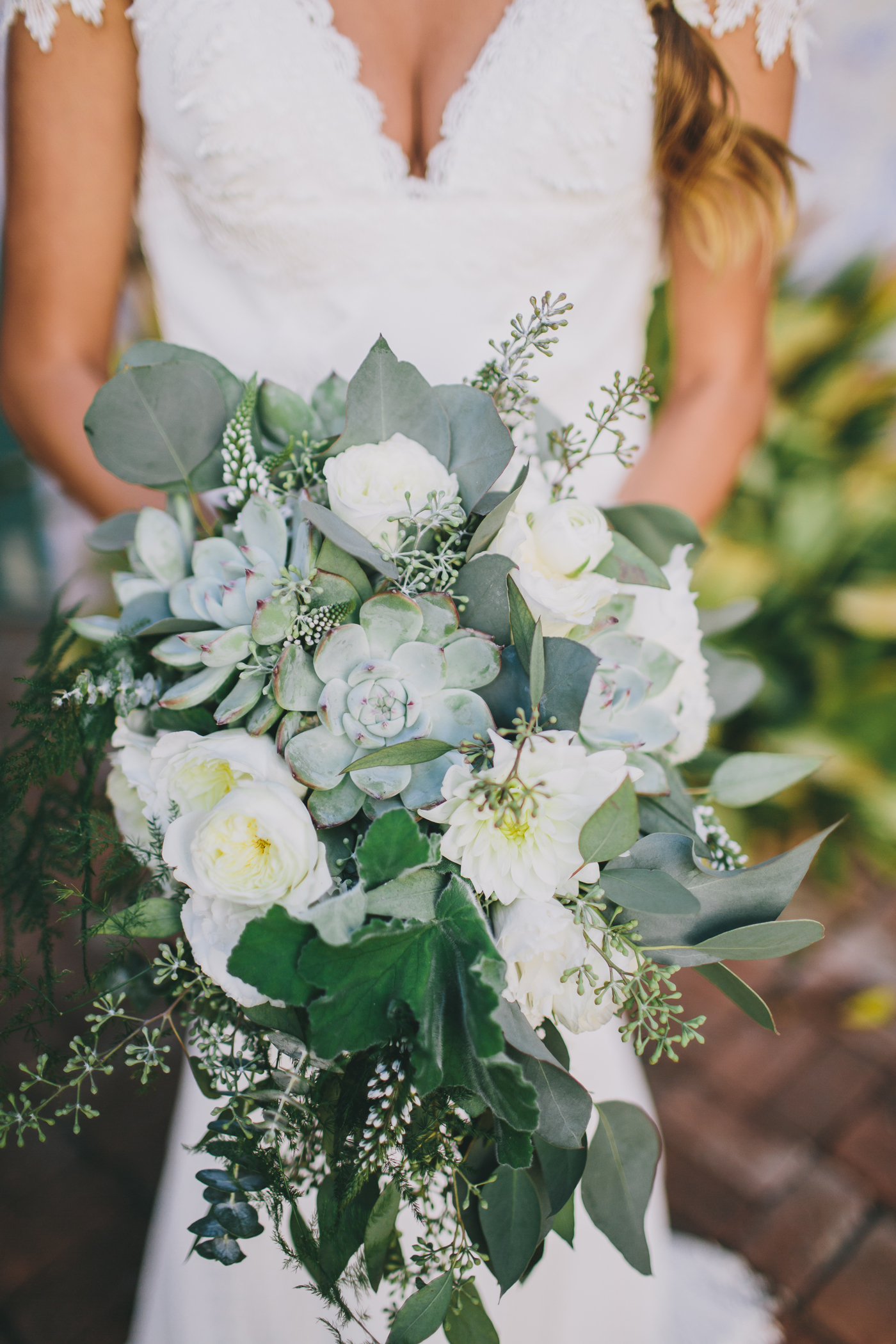 bouquet of succulents roses dahlias and greenery