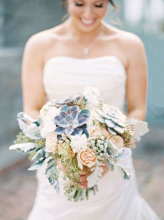 green-and-blue succulents with mint-hued berries wintry bouquet