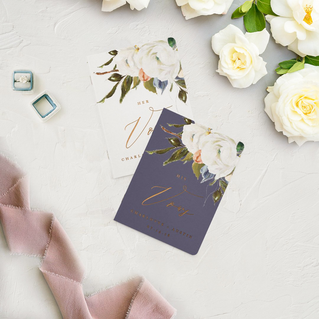 vow books flower topped with gold writing
