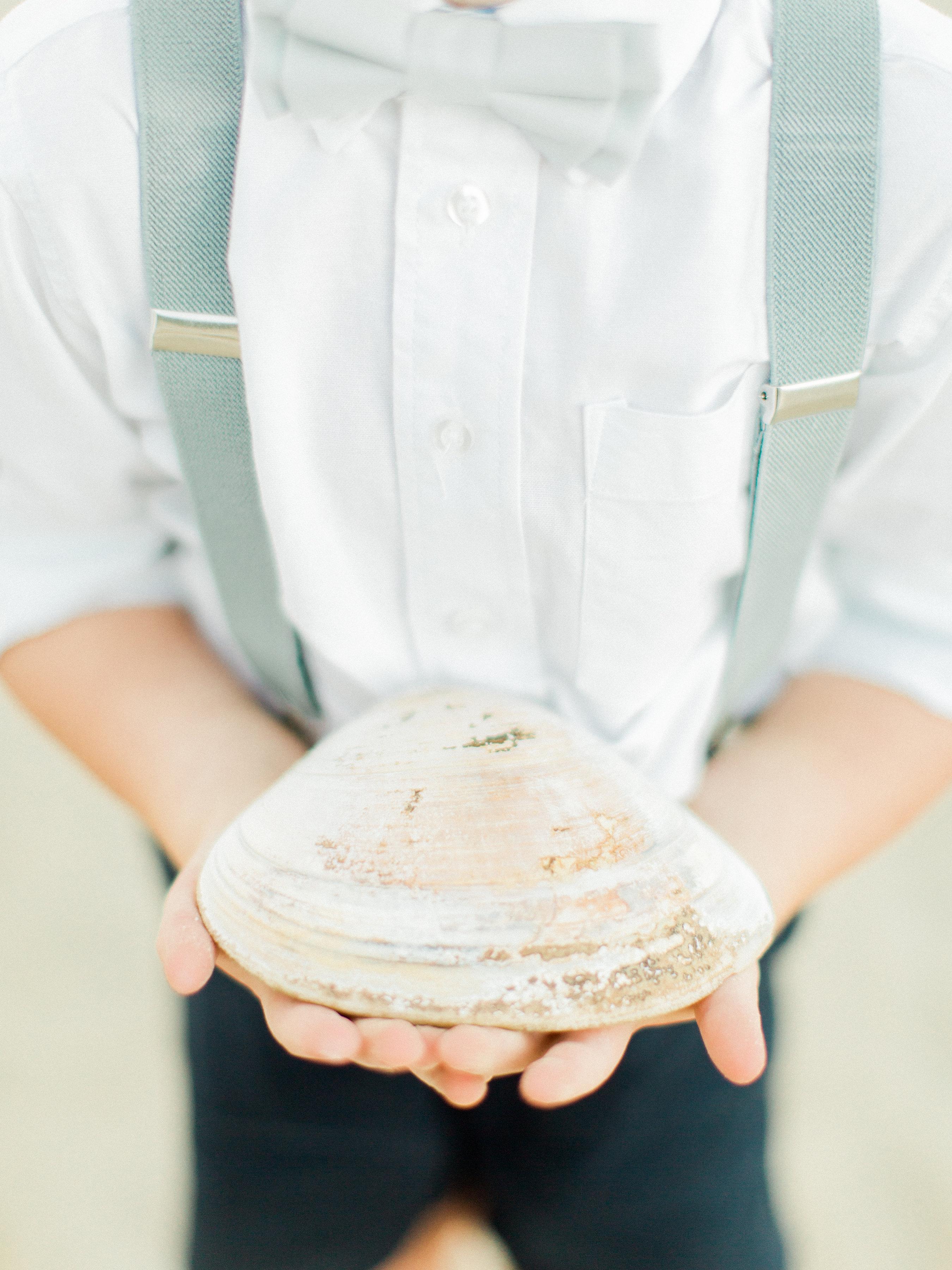 Ring Bearer Holding a Shell