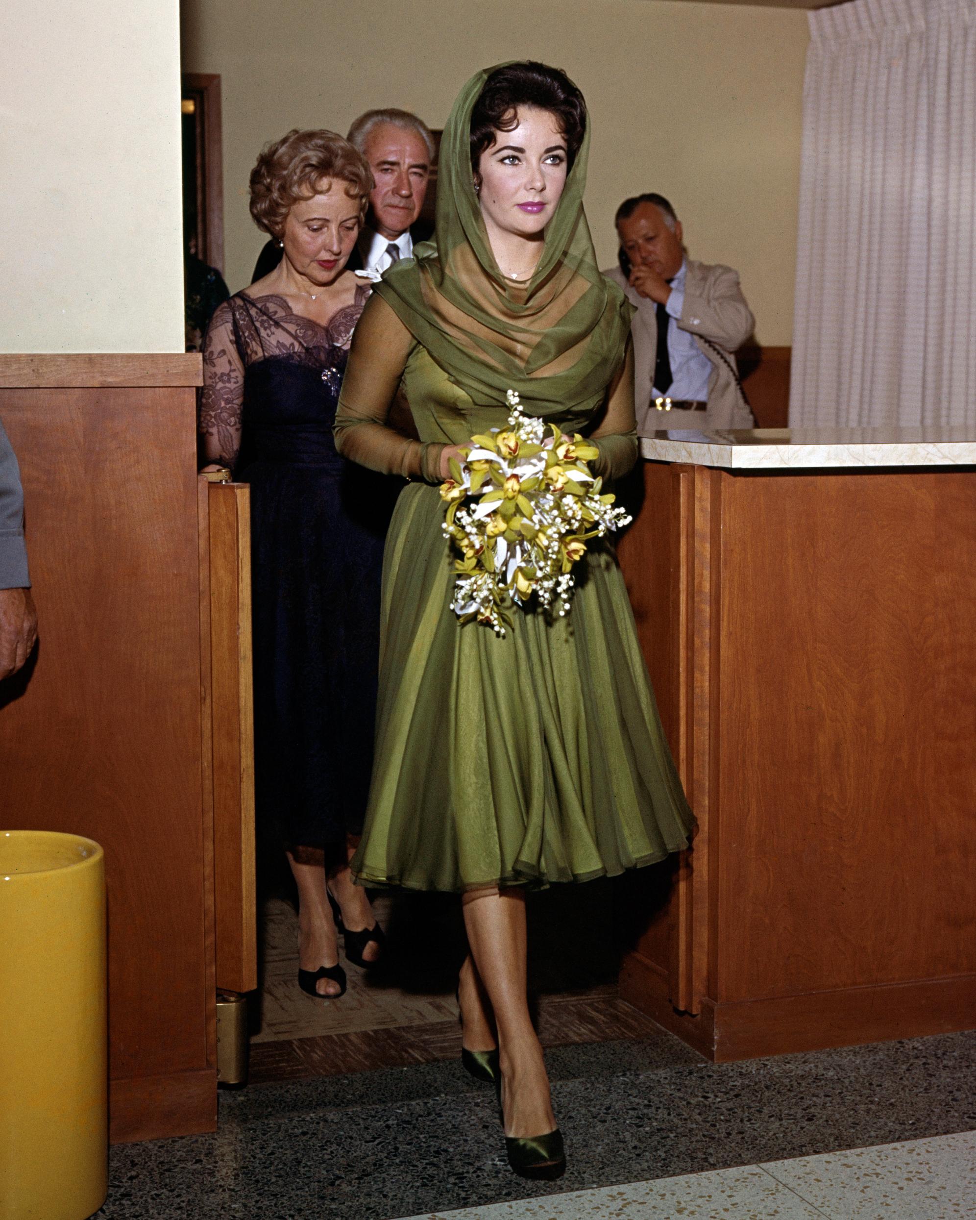 celebrity-colorful-wedding-dresses-elizabeth-taylor-green-gettyimages-536210215-0815.jpg