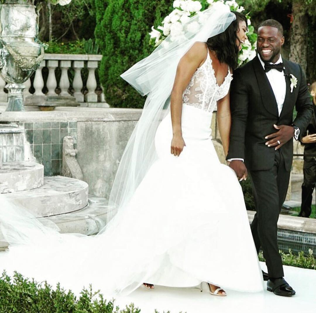Kevin Hart and Eniko Parrish walking up the aisle