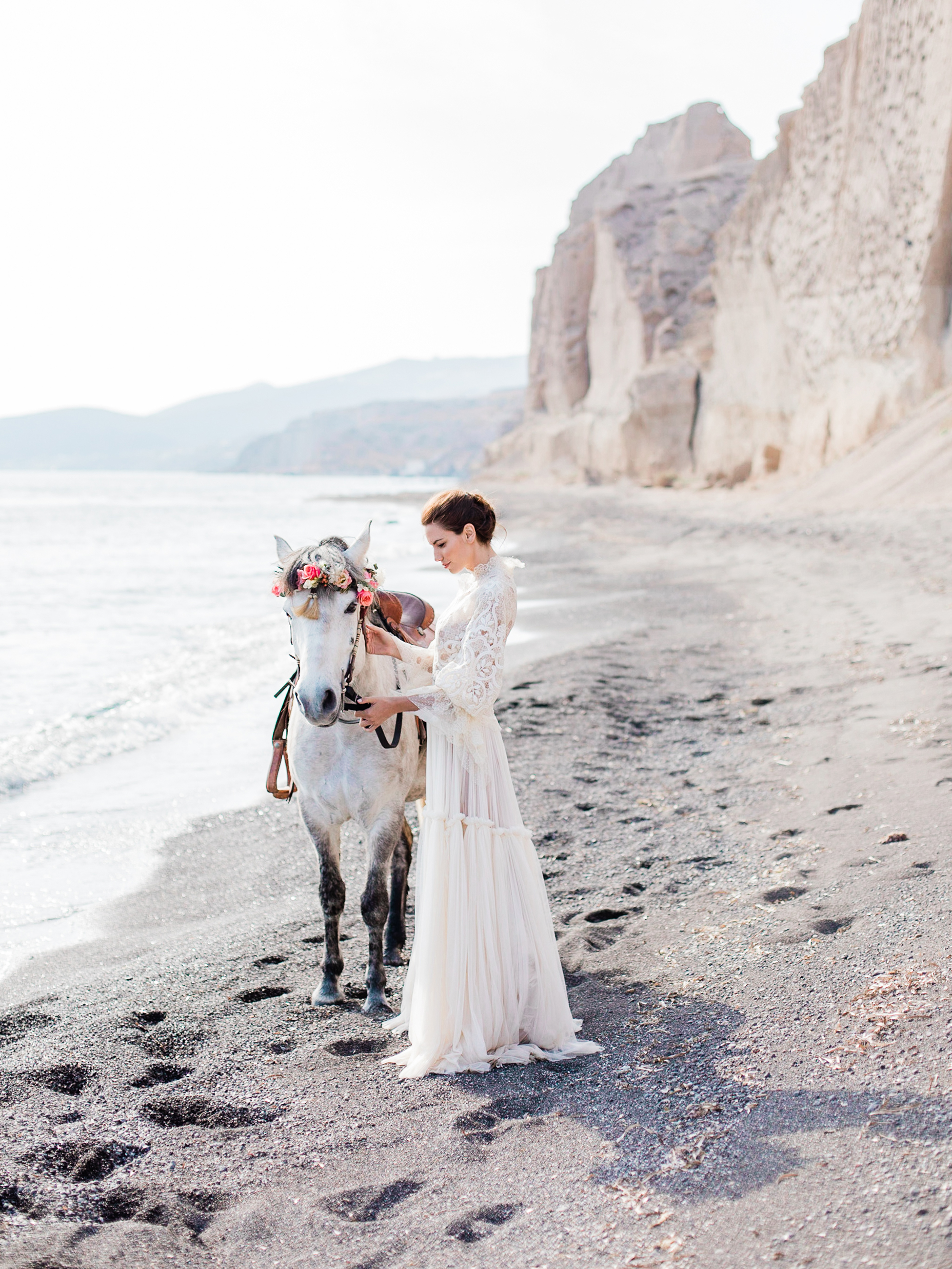 beach wedding dresses bride with horse on the beach