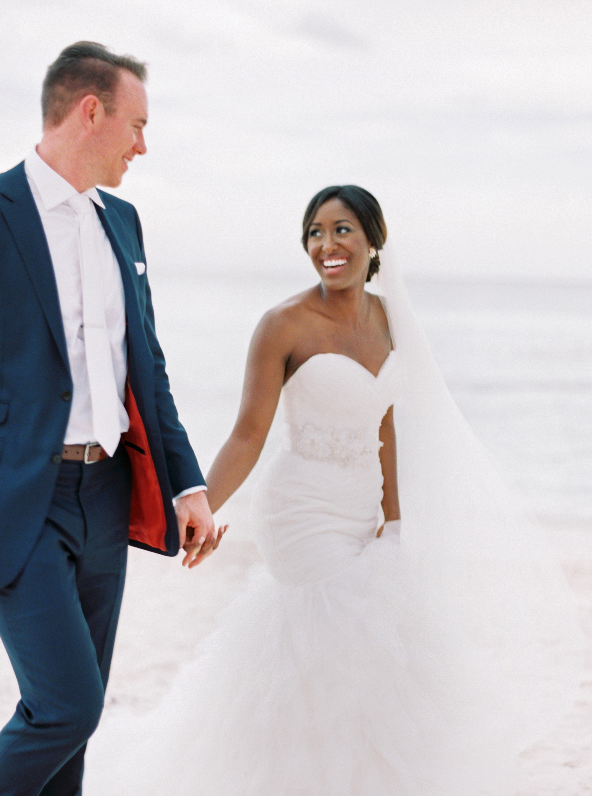 beach wedding dresses bride and groom holding hands