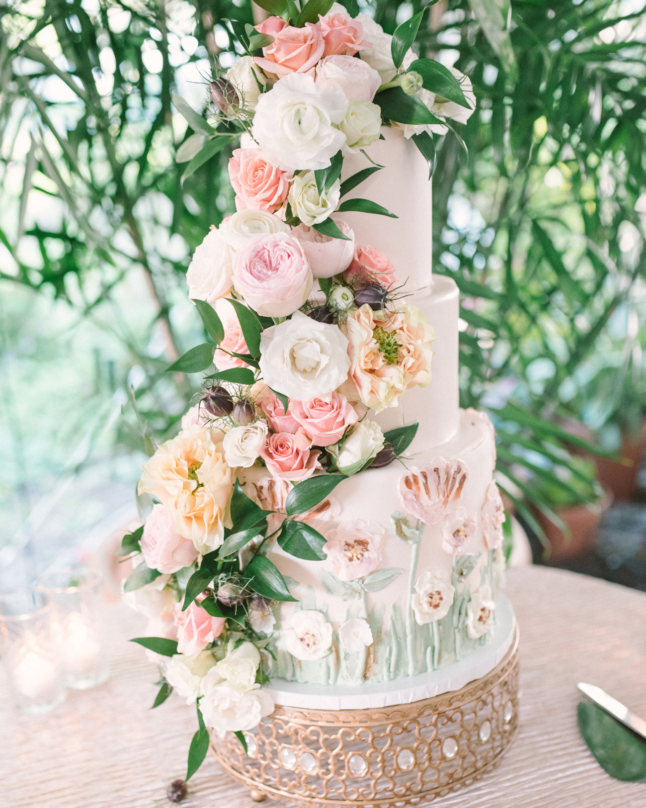 pink white and peach floral covered wedding cake