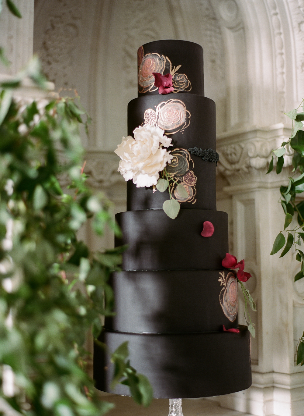 black wedding cake with floral details