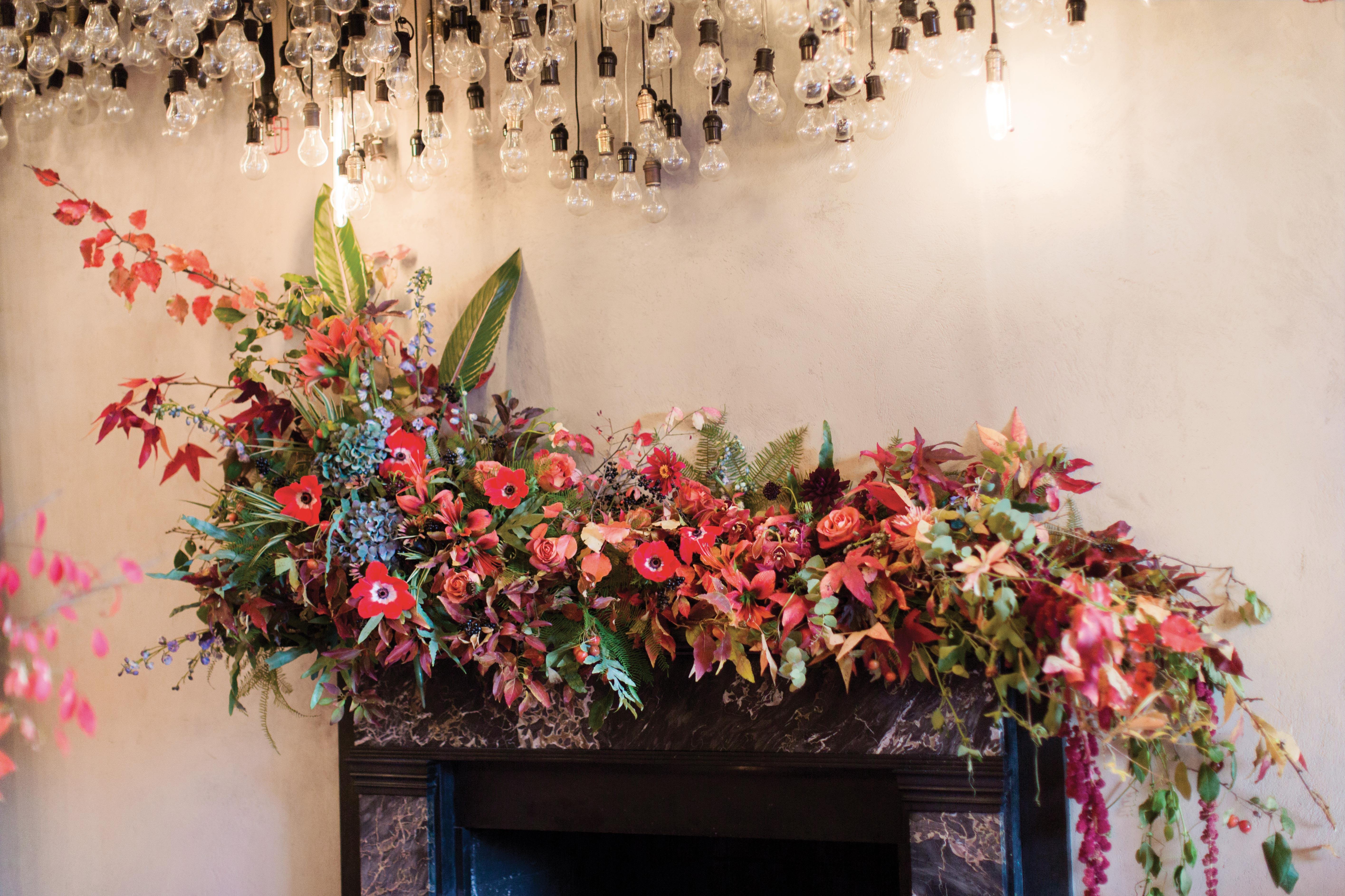 glara matthew wedding mantel floral arrangement