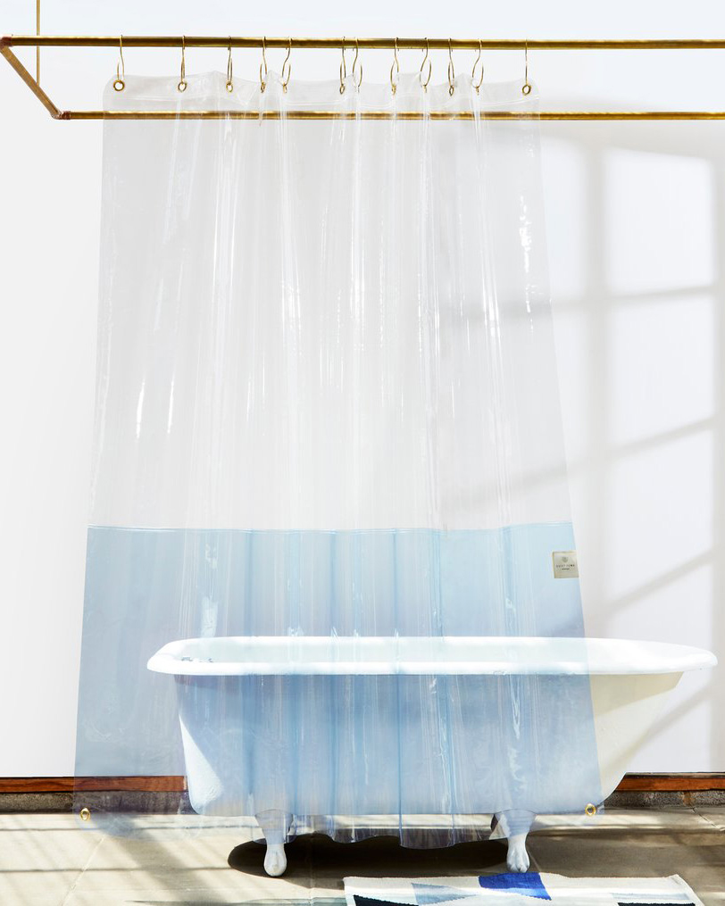 translucent show curtain around white tub