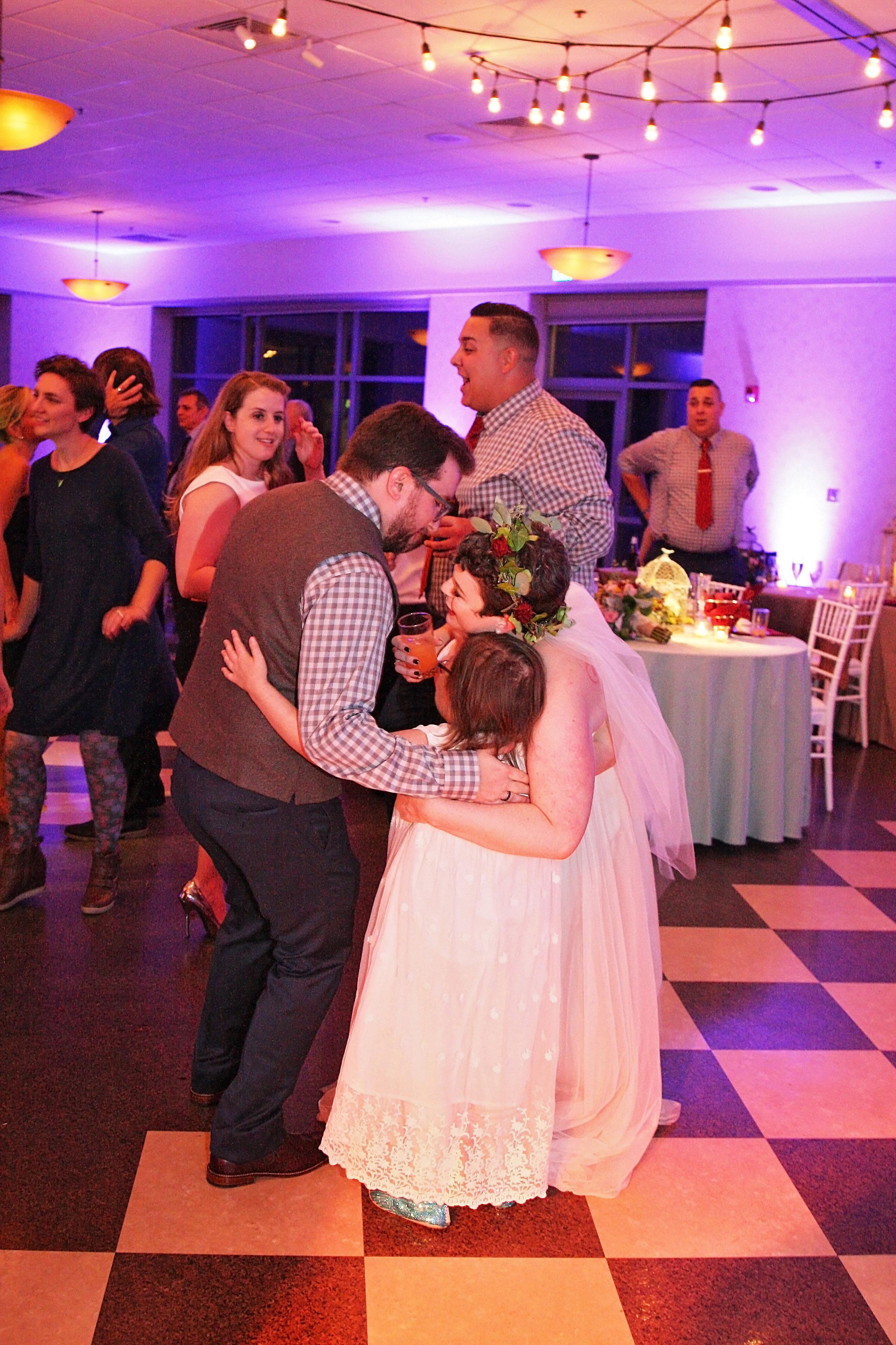 survivor flower girl wedding hug