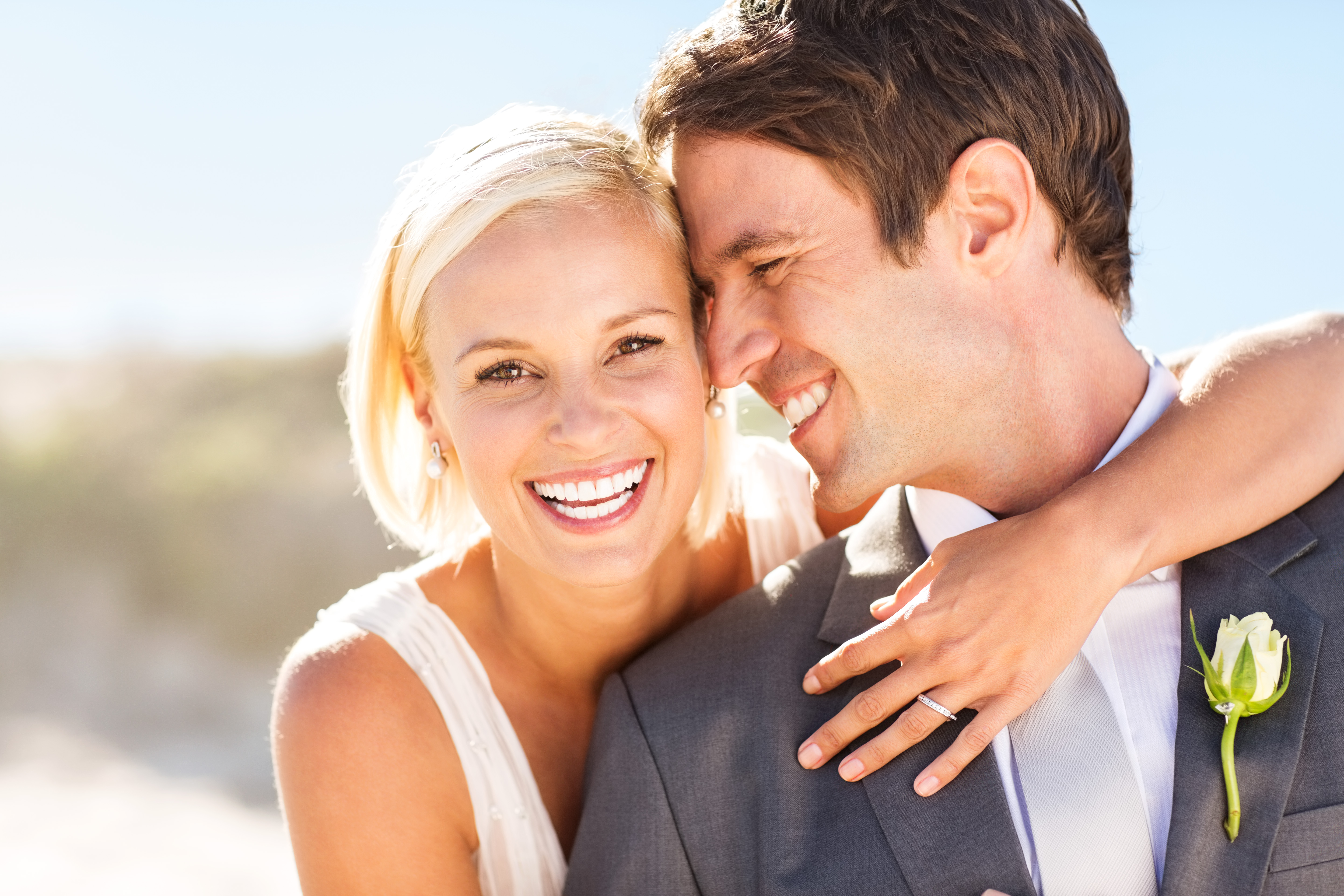 Bride and groom smiling with teeth