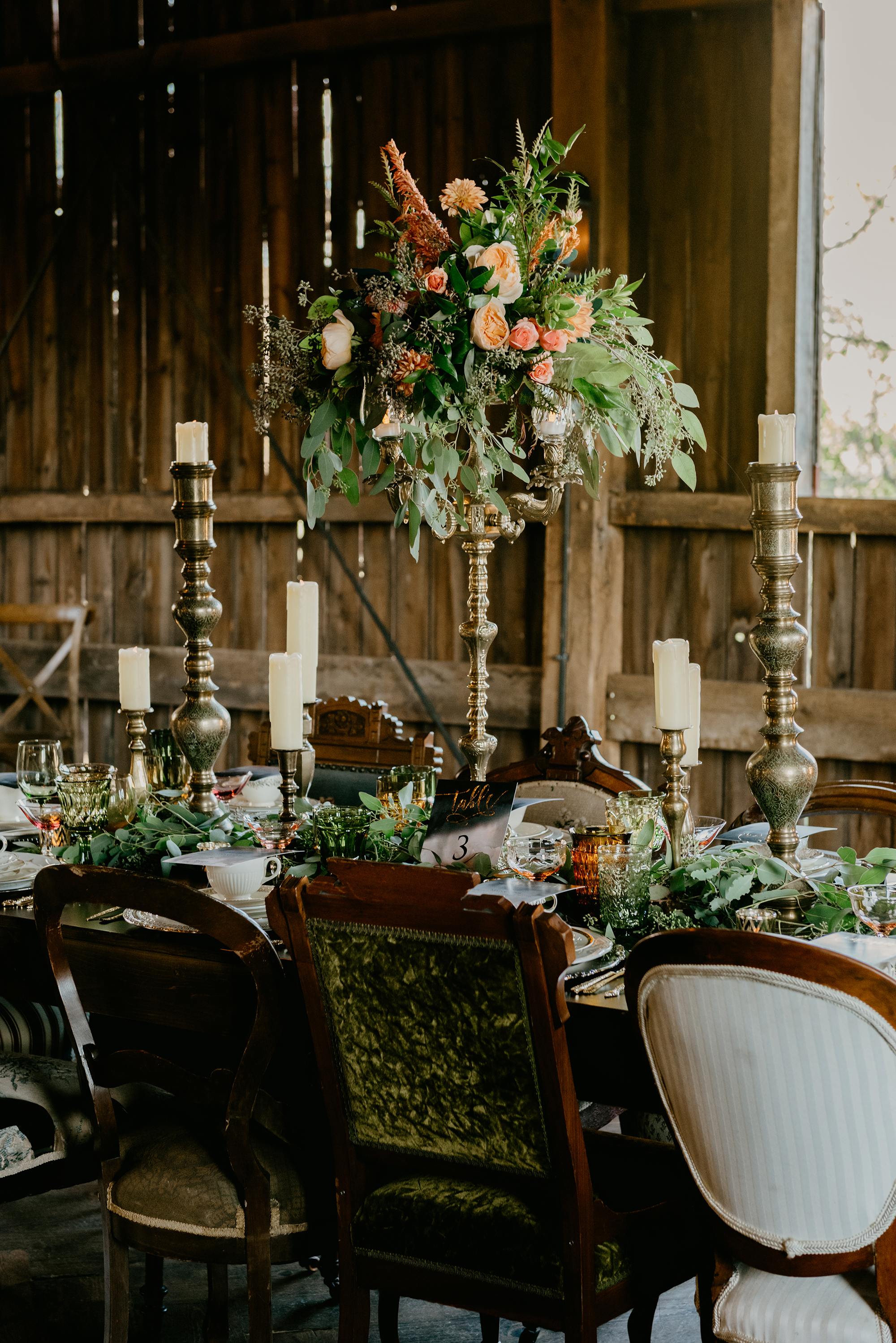 tall centerpiece with garden roses and ranunculus