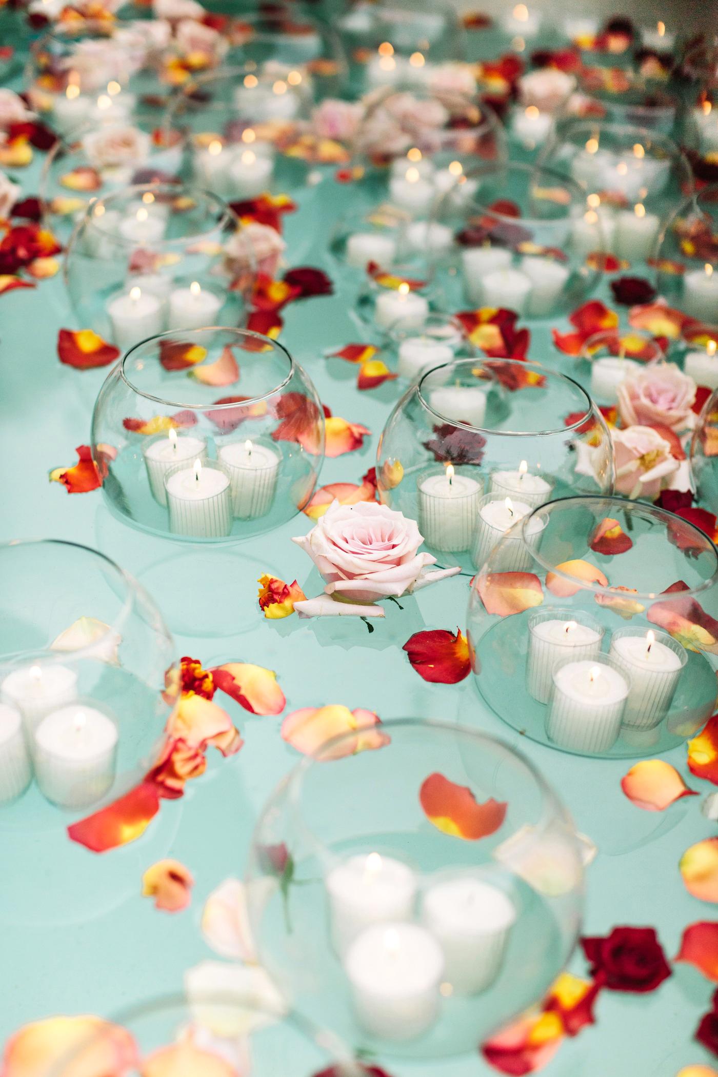 regina chris wedding floating petals candles