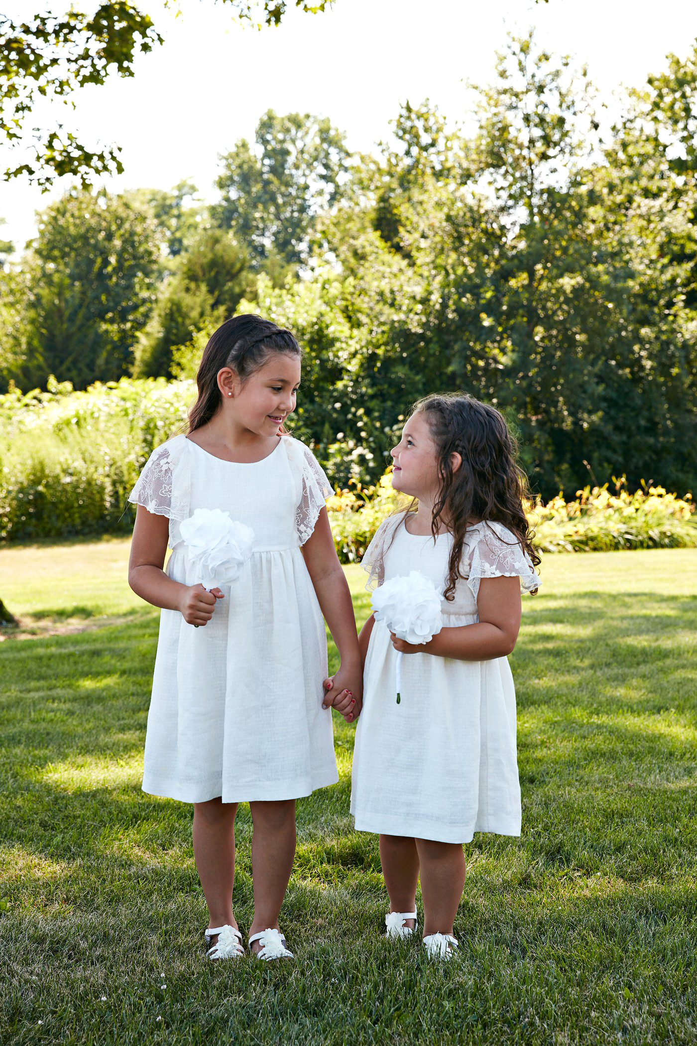 flower girls with white flowers