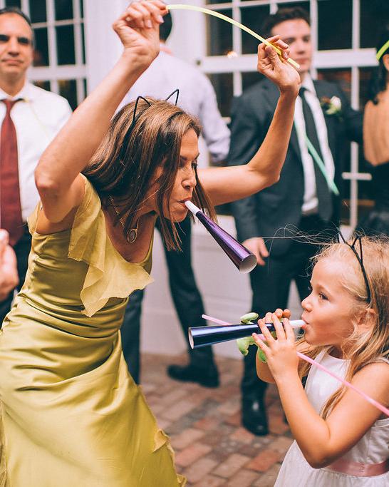 wedding guests dancing horns