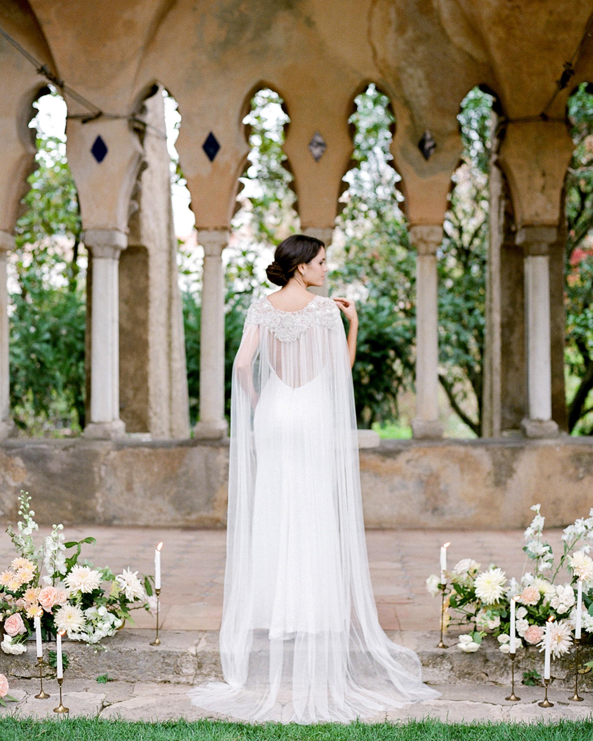 bride wearing embellished tulle bridal cape