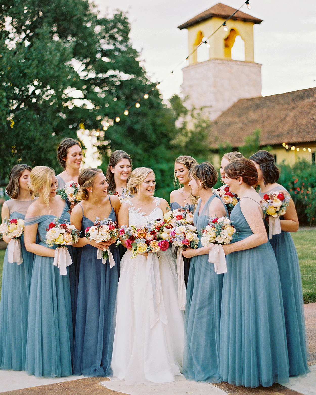 bride and bridesmaids with blue tulle gowns