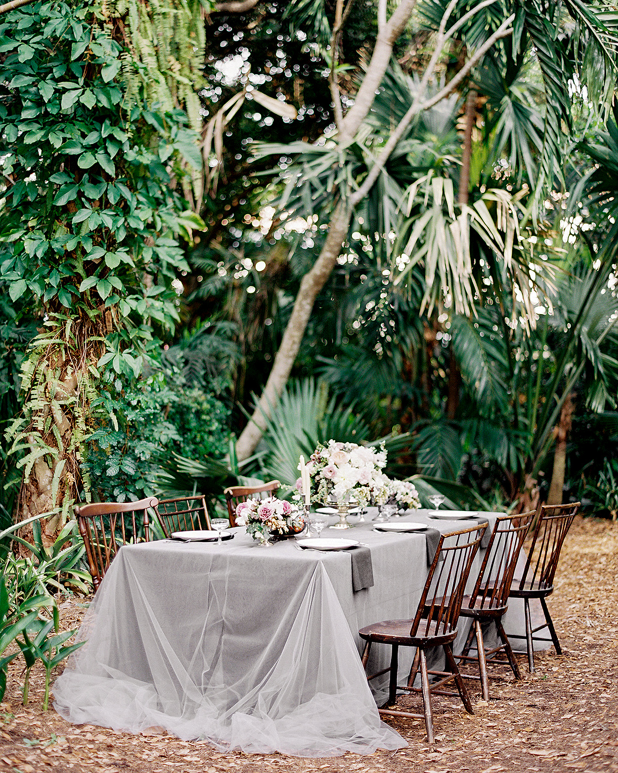gray tulle overlay and florals on outside table