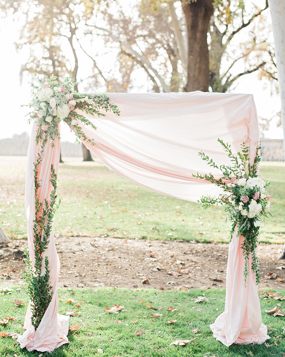 pink dyed tulle gathered on ceremony structure