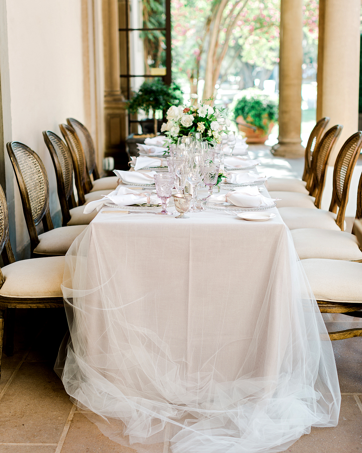 white tulle overlay on reception table