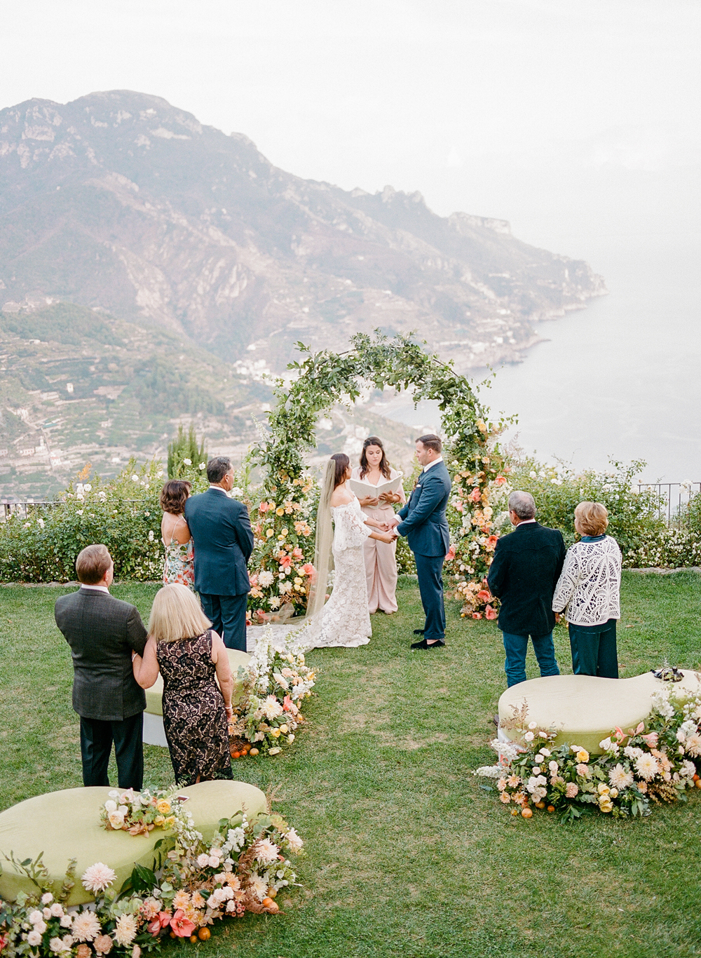 floral arch outdoor wedding ceremony on Italian coast