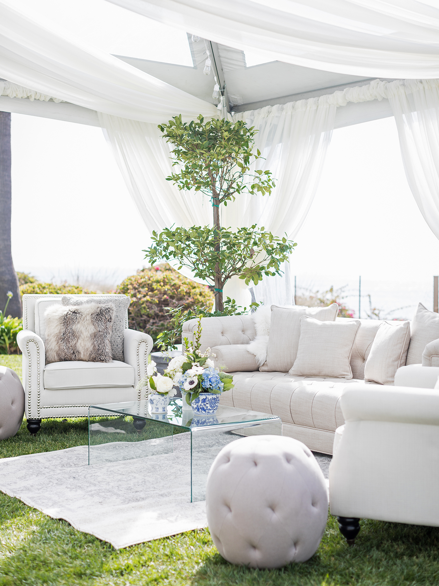 wedding lounge tent with white furniture