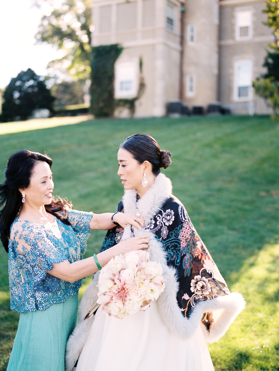 Mother Helping Her Daughter on Her Wedding Day