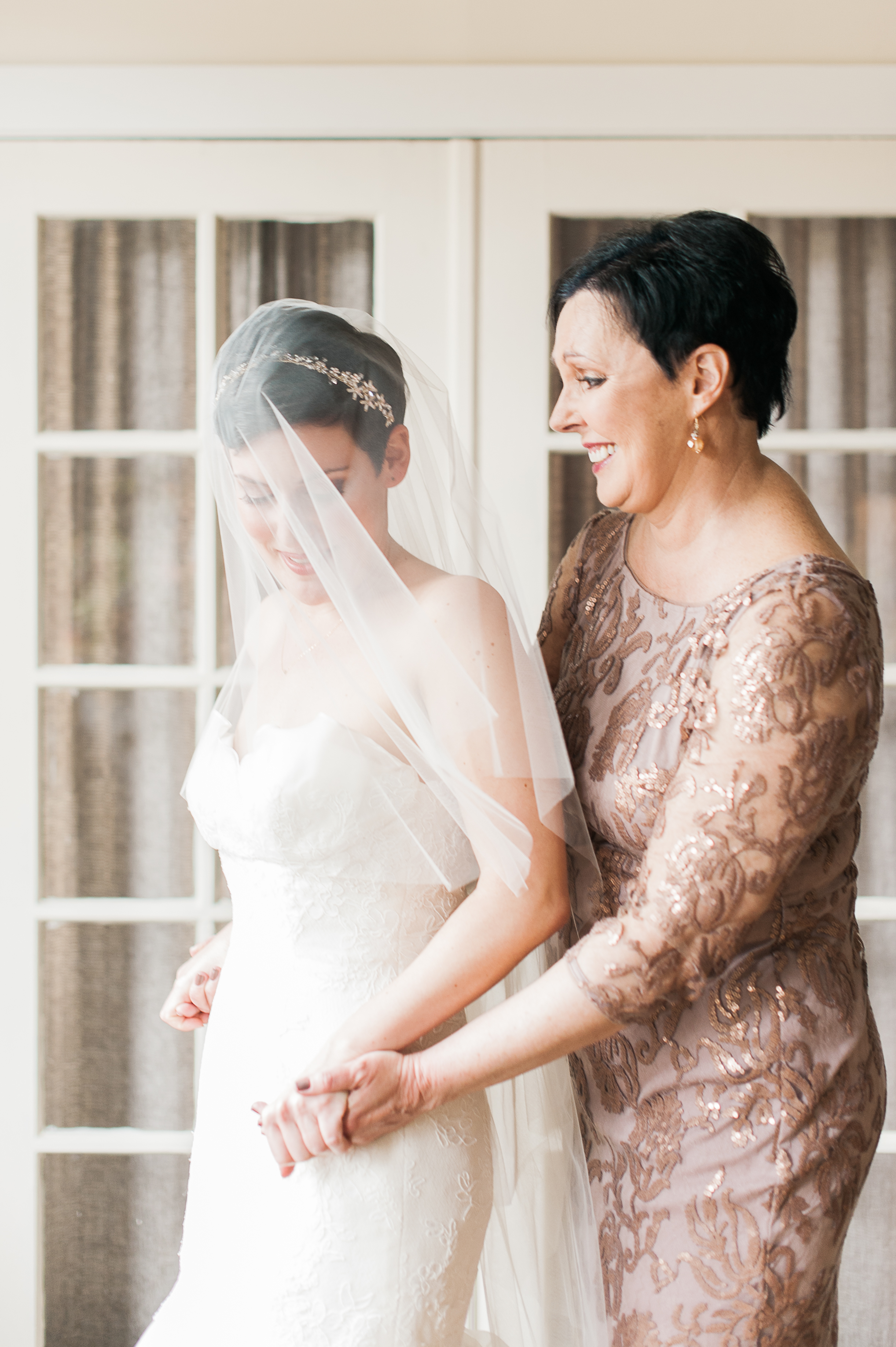 A Bride and Her Mom Holding Hands
