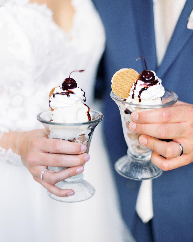 bride and groom each holding an ice cream sundae