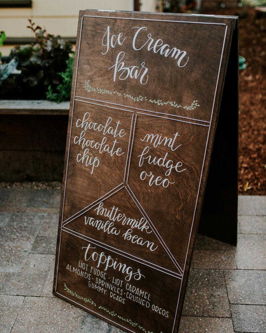 ice cream menu on wooden sign