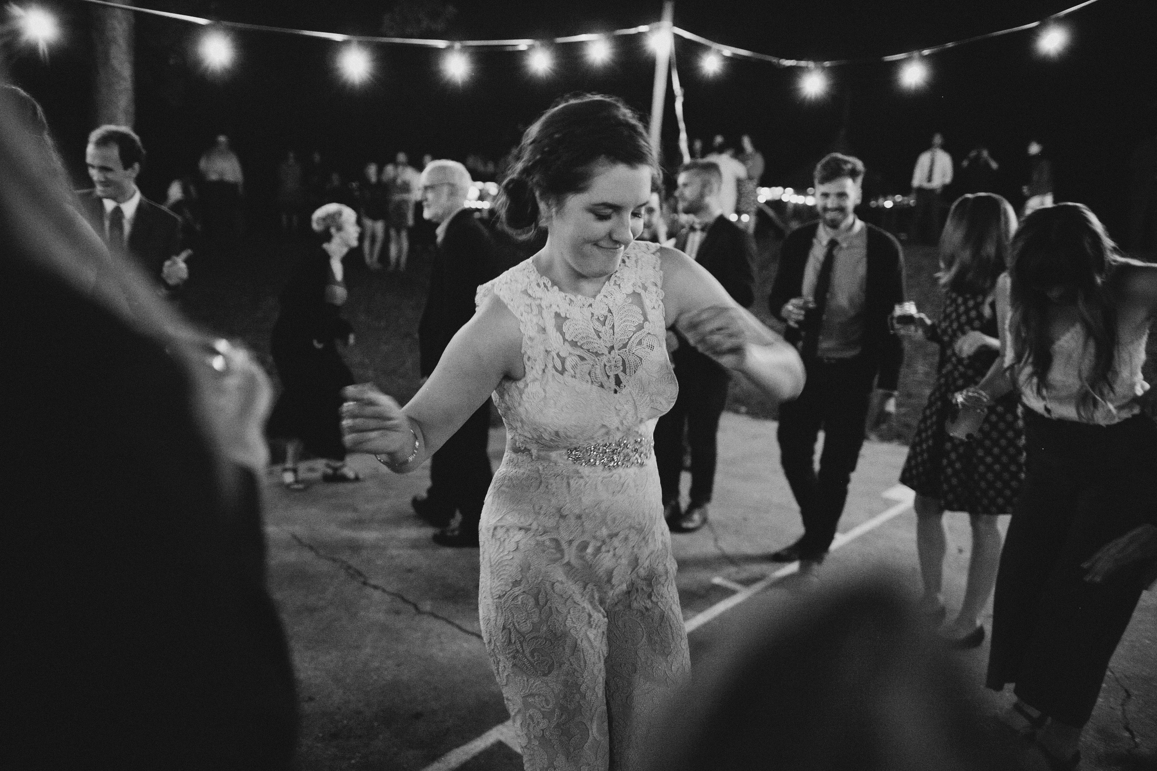 Bride in a Jumpsuit Dancing at Her Wedding