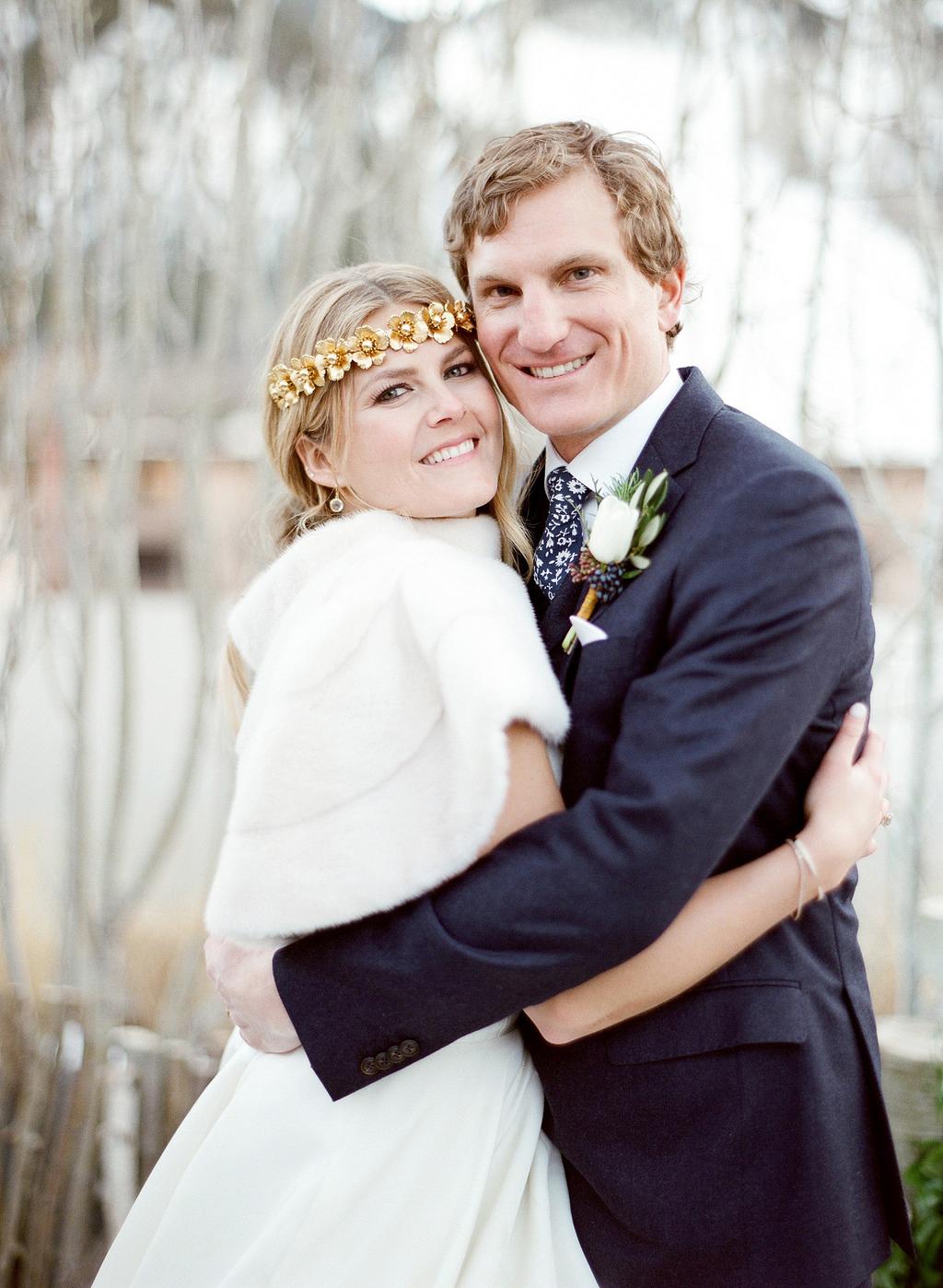 winter wedding couple hug