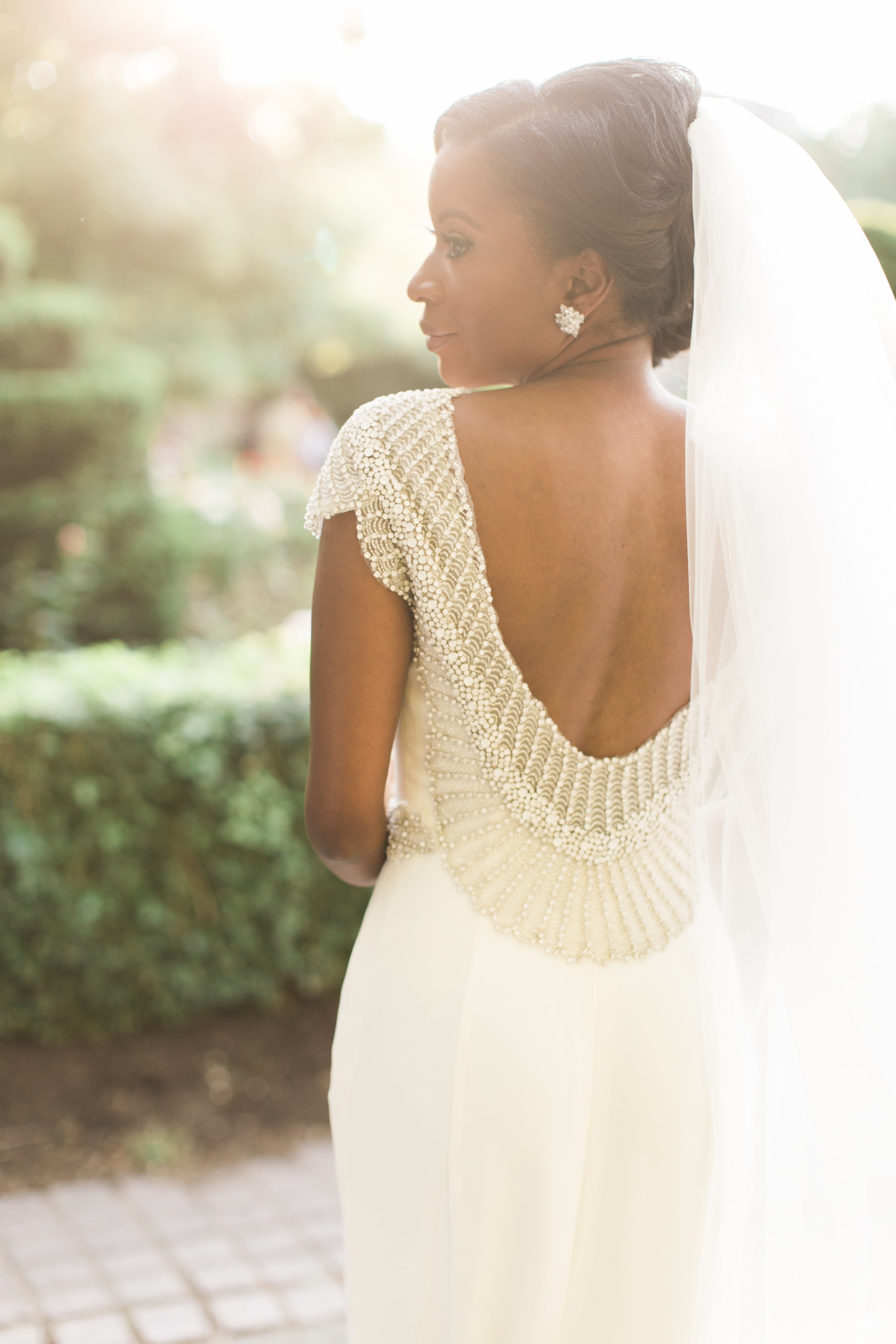 A Bride with a Beaded Open-Back Wedding Dress