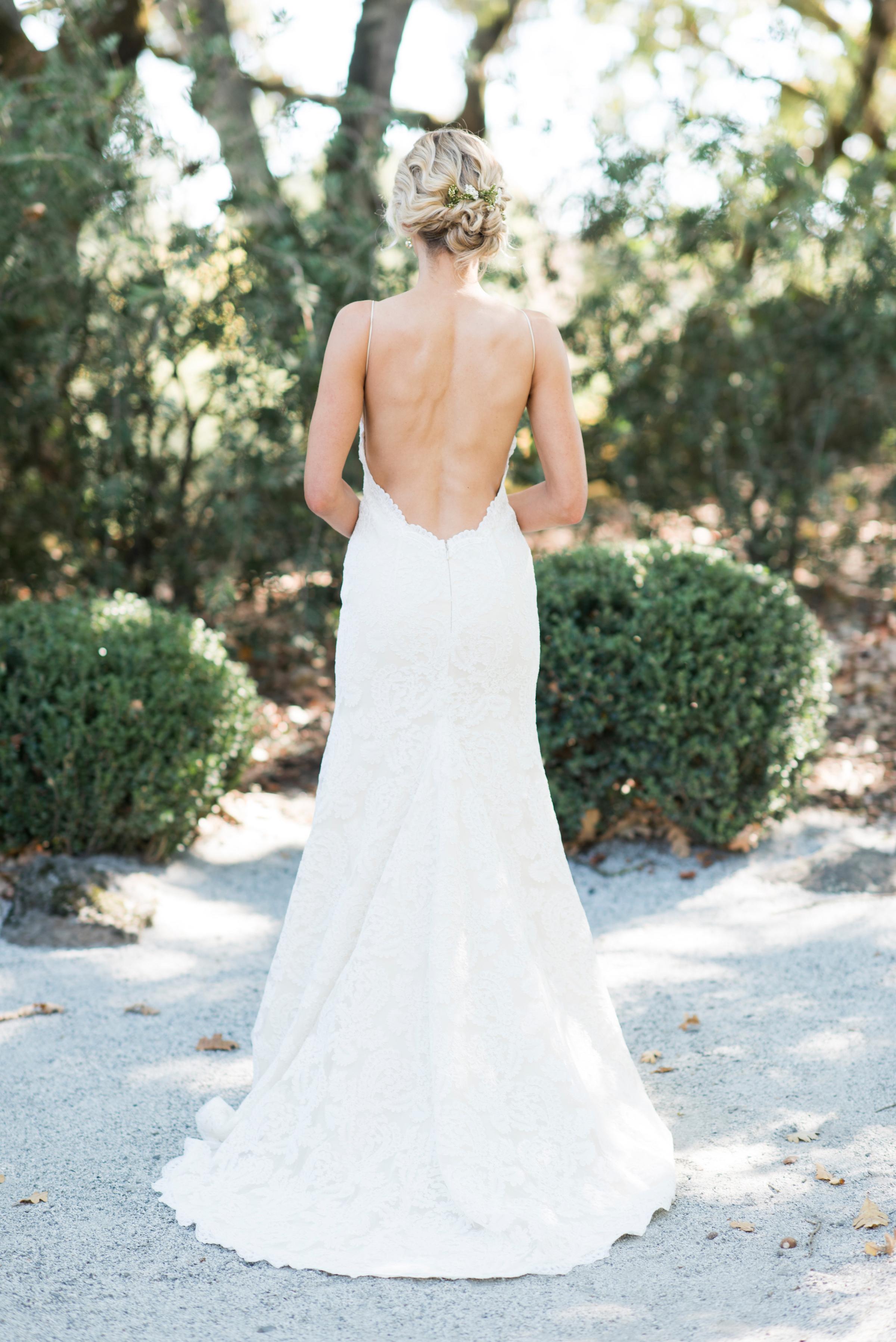 A Bride Wearing an Open-Back Wedding Dress