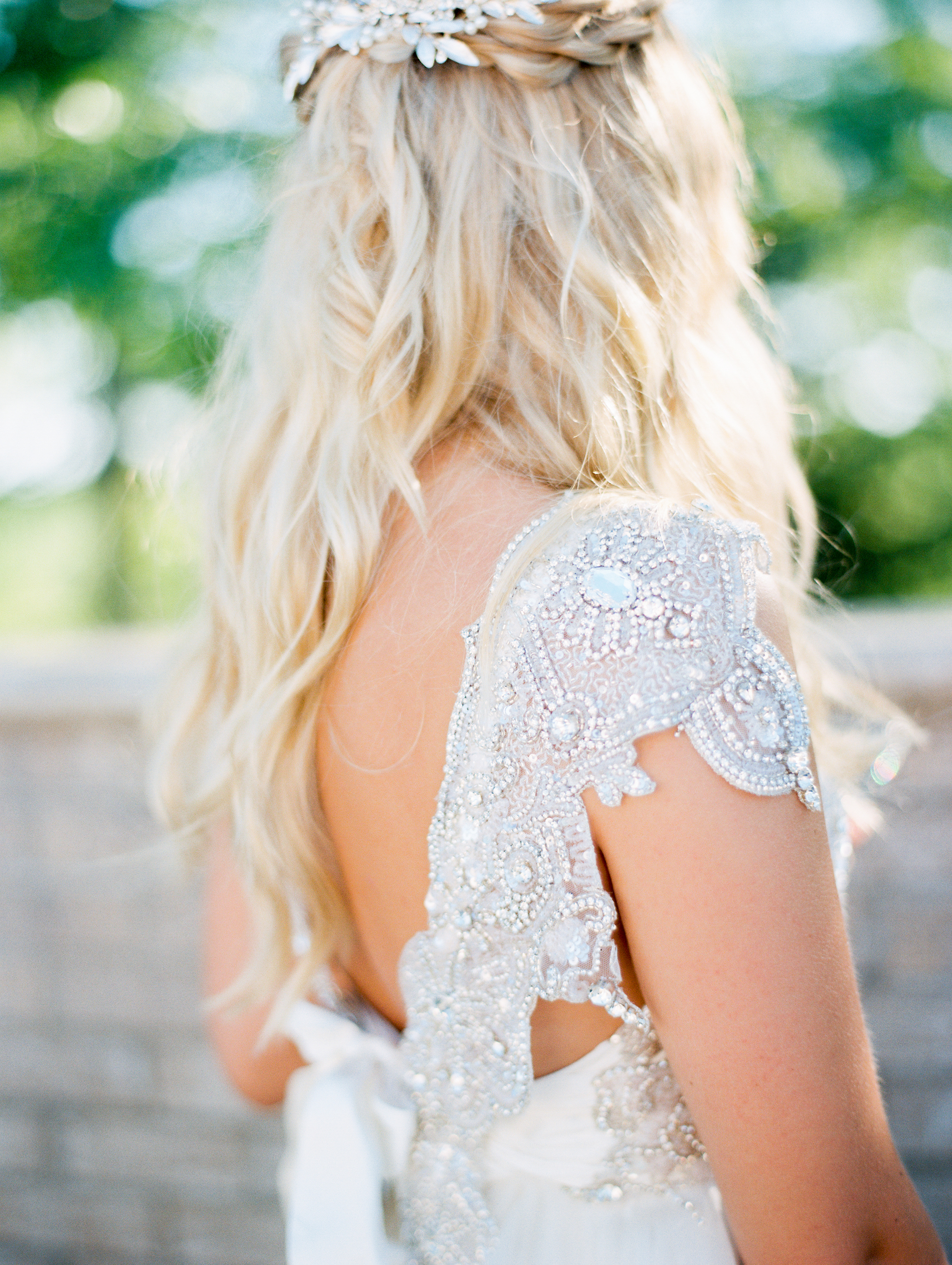 A Bride with a Wedding Dress That Has Jeweled Back Details
