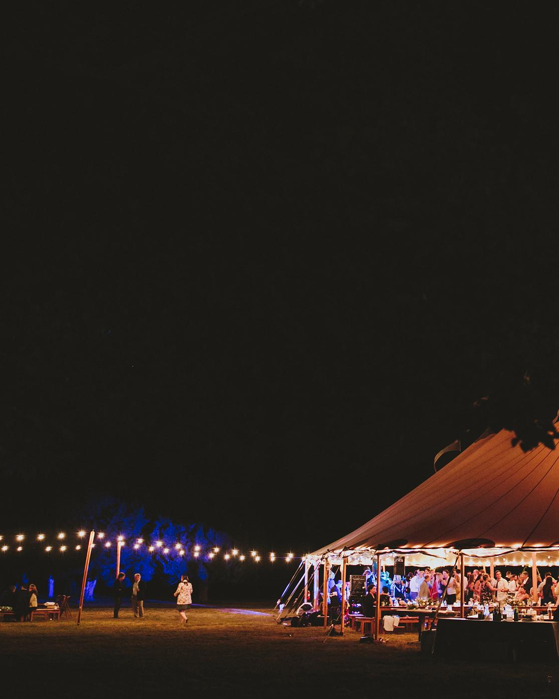 hadley corey wedding tent exterior night lights
